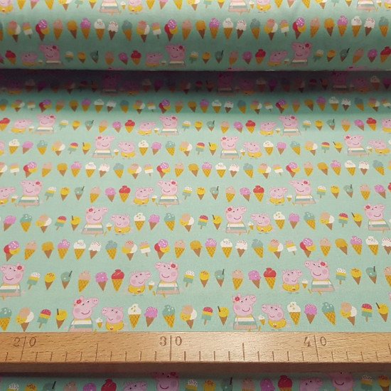 Cotton Peppa Pig Summer Ice Cream fabric - Licensed cotton poplin fabric with drawings of Peppa Pig and George eating ice cream, on a green background. The fabric is 150cm wide and its composition is 100% cotton.