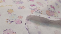 Cotton Hello Kitty fabric - Very nice cotton fabric by Hello Kitty where pink colors predominate. Drawings of the kitten appear in various positions alternating roses and hearts.