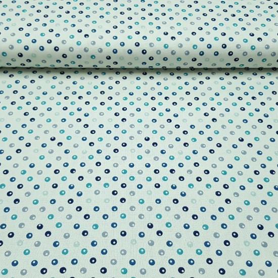 Tela Patchwork Lino Círculos - Tela de aspecto lino o half panamá para Patchwork, con dibujos de círculos en colores azules y grises sobre un fondo blanco. La tela mide 140cm de ancho y su composición 50% poliester –40% algodón –10% lino.
