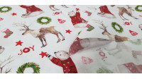 Cotton Christmas Joy Bears and Reindeers fabric - Christmas-themed organic cotton fabric with drawings of bears with red sweaters, reindeer and various Christmas decorations, on a white background. The fabric is 150cm wide and its composition is 100% cott