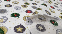 Cotton Christmas Balls Ornaments Stars White fabric - Christmas cotton fabric with drawings of balls with ornaments in green, red and gold tones, on a white background with little stars. The fabric is 140cm wide and its composition is 100% cotton.