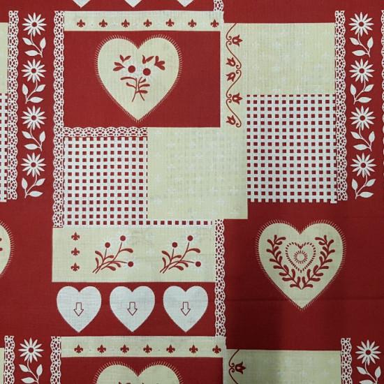 Tela Algodón Navidad Corazones Cuadros - Tela de algodón con dibujos de corazones de varios tamaños, cuadros y plantas sobre un fondo rojo y crema. Esta tela es ideal para creaciones de temática navideña. La tela mide 140cm de ancho y su composición 100%