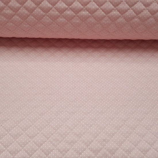 Quilted Pique White Polka Dot Pink Background fabric - Pink quilted piqué fabric with small white dots. Ideal fabric for children's projects and especially baby accessories such as bags, changing tables, diaper envelopes ... The fabric is 150cm wide and i