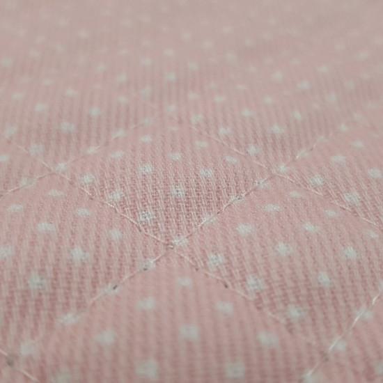 Tela Piqué Acolchado Lunares Blancos - Tela de piqué acolchada de color rosa con lunares blancos pequeños. Tela ideal para proyectos infantiles y sobretodo complementos de bebé como bolsas, cambiadores, sobres para pañal... La tela mide 150cm de ancho y s