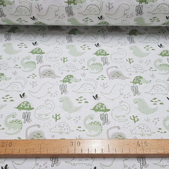 Pique Dinosaurs Cactus Green fabric - Piquecanutillocotton fabric with drawings of dinosaurs and cacti where green colors predominate. The fabric is 150cm wide and its composition is 100% cotton.