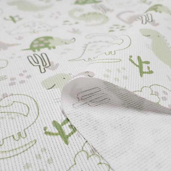 Tela Piqué Dinosaurios Cactus Verde - Tela de piqué canutillo algodón con dibujos de dinosaurios y cactus donde predominan los colores verdes. La tela mide 150cm de ancho y su composición 100% algodón.
