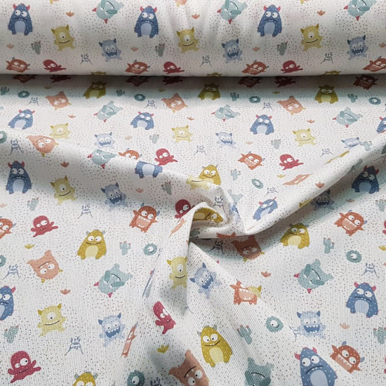 Pique Funny Monsters fabric - Pique fabric for children with drawings of funny colored monsters on a white background with tiny colored dots. The fabric is 150cm wide and its composition is 100% cotton.