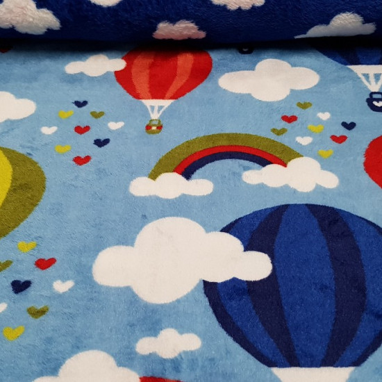 Fleece Coral Double Sided Balloons fabric - Very soft double-sided coral fleece fabric, that is, a drawing on each side of the fabric. Drawings of balloons, clouds, rainbows and hearts appear on a background in blue tones.