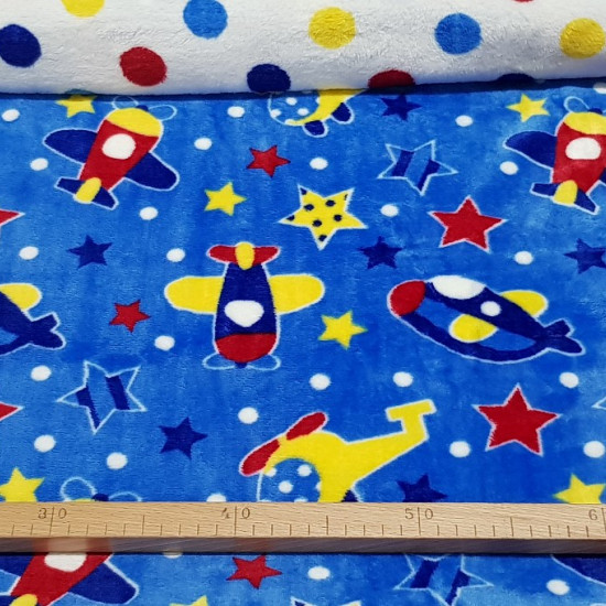 Coral Fleece Double Sided Aircraft fabric - Very funny double-sided coral fleece fabric, that is to say, a drawing for each side of the fabric. On this fabric there are drawings of planes, helicopters, stars and polka dots on a blue background. On the oth