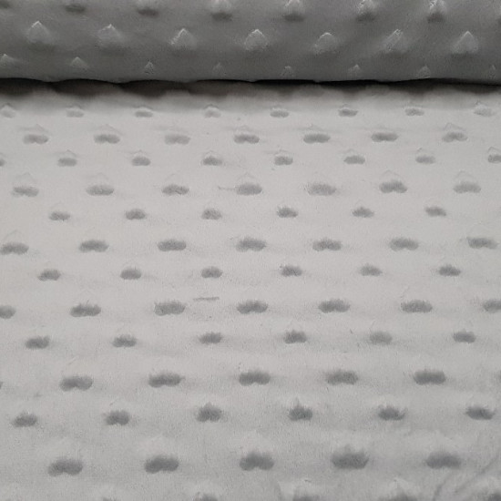 Tela Polar Minky Corazones - Tela de Polar muy suave con formas en relieve de corazones. También es conocida como tela Minky, por el relieve sobre la tela polar. Se pueden apreciar dos tamaños de corazones, dibujando una serie consecutiva sobre la t