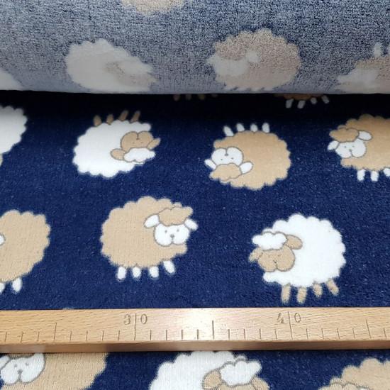 Tela Polar Coralina Ovejas - Tela de polar tipo coralina con dibujos de ovejas sobre un fondo azul oscuro. Tela calentita y suave de temática infantil.