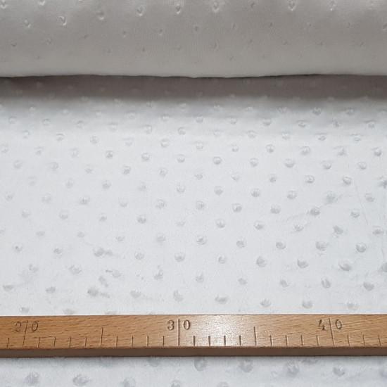 Tela Polar Minky Botones - Tela de polar tipo Minky suave y calentita con protuberancias o botones en relieve. Esta tela es ideal para la confección de arrullos para bebé, mantas infantiles, fundas para el carrito…y mucho más La tela mide 150