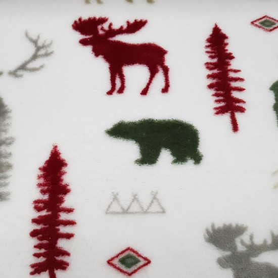 Coral Fleece Reindeer Bears fabric - Coral fleece fabric with drawings of reindeer, bears, tipi tents, mountains... on a white background. The fabric is 150cm wide and its composition 100% polyester.