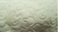 Fleece Relief Animal Stars Off White fabric - Very soft fleece fabric with relief patternsof animals and stars in a color off-white fabric. Ideal for blankets, baby lullabies, scarves, necks… The fabric is 150cm wide and its composition is 100% polyester