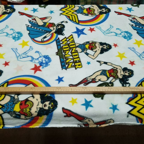 Poly Fleece Wonder Woman fabric - DC Comics licensed poly fleecefabric with Wonder Woman drawings on a white background with colored stars. This fabric is ideal for making blankets and large projects. The fabric measures 145cm wide and its 100% poly