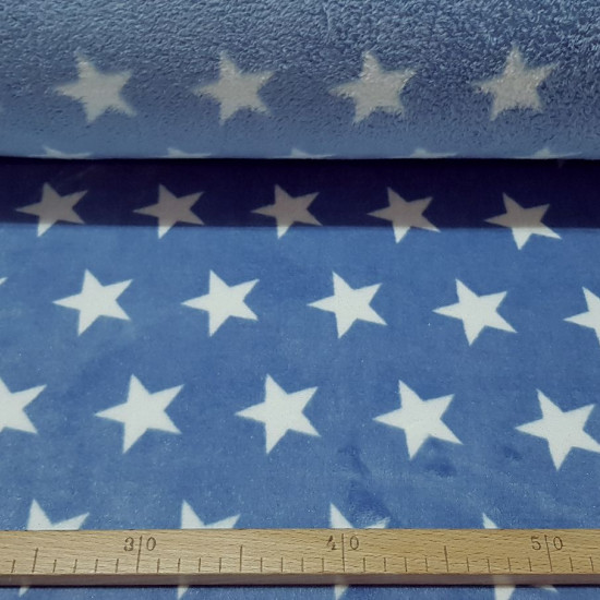 Coral Fleece Stars Glitter Blue fabric - Coral fleece fabric in glitter style with drawings of white stars on a blue background. The fabric is 150cm wide and its composition is 100% polyester.