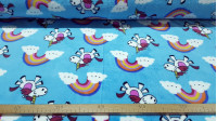 Coral Fleece Rainbow Unicorns fabric - Coral fleece fabric with children's drawings of unicorns and rainbows on a turquoise blue background. The fabric is 150cm wide and its composition is 100% polyester.