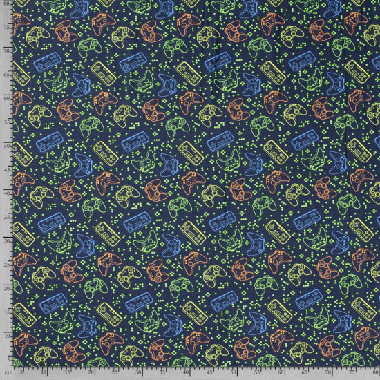 Jersey Videogames Controllers fabric - Jerseyfabric with drawings of game console controllers on a navy blue background with pixels in contrasting green color. The fabric is 150cm wide and its composition is 95% cotton - 5% elastane.