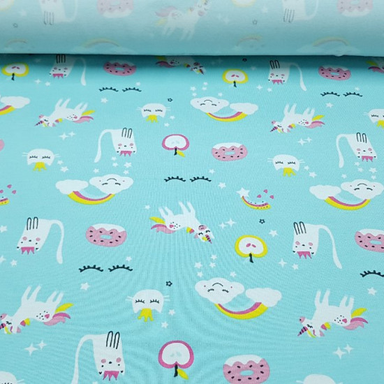 Cotton Jersey Unicorns Turquoise fabric - Beautiful knitted cotton jersey fabric with drawings of unicorns, clouds with rainbows, donuts, stars ... on a turquoise blue background. The fabric is ideal for children's clothing and other creations such as dec