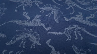 Softshell Dinosaurs Glow in the Dark fabric - Softshell fabric with drawings of dinosaur skeletons, which glows in the dark. The background color is a dark blue. The Softshell fabric is a functional fabric that consists of 3 layers, the outer layer has a