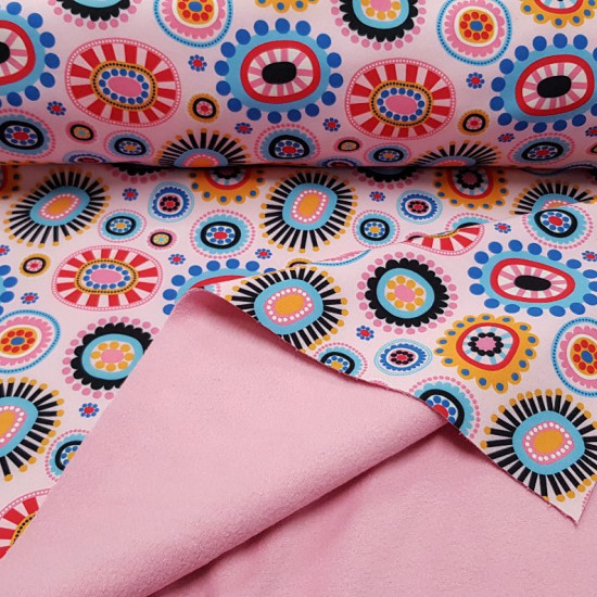 Softshell Flowers Shapes Pink fabric - Softshell fabric in digital print with flower drawings, circles in the shape of flowers of many colors on a pink background. The inner part that carries the fine polar is also pink. The Softshell fabric is composed o