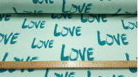 """Tela Punto Algodón Love Verde - Tela de punto algodón tipo camiseta con dibujo de letras """"Love"""" sobre un fondo verde menta. La tela mide 150cm de ancho y su composición 95% algodón –5% elastán"""