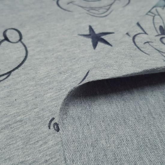 Tela Punto French Terry Disney Minnie Azul - Tela de punto algodón sudadera tipoFrench Terry licencia Disney con dibujos de caras de Minnie con lazos de colorverde menta y estrellas en trazos negros sobre un fondo gris melange. La tela French Terry o fe