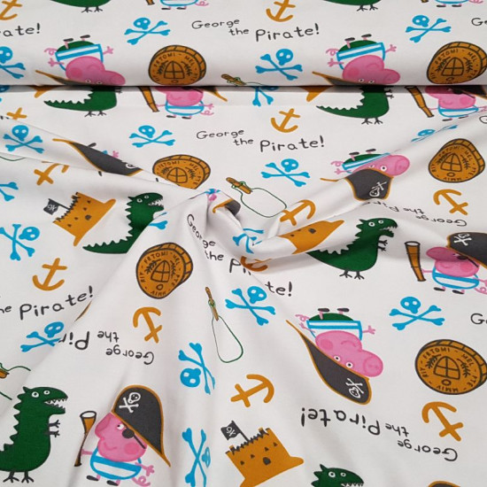 Cotton Jersey George Pirate fabric - Licensed cotton jersey fabric with drawings of the character George from the tv seriesPeppa Pig, disguised as a pirate with his inseparable dinosaur on a background with objects such as anchors, coins, sandcastles...