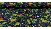 Tela Punto Algodón Dinosaurios Volcanes - Tela de punto algodón tipo camiseta con dibujos de dinosaurios, vegetación y volcanes sobre un fondo azul oscuro. La tela mide 150cm de ancho y su composición 95% algodón - 5% elastano.