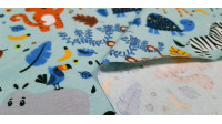 Cotton Jersey Jungle Animals Blue fabric - Cotton jerseyfabric with funny drawings of jungle animals waving, such as tiger, panda, giraffe... The fabric is 150cm wide and its composition is 95% cotton - 5% elastane.