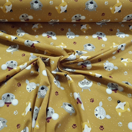 Cotton Jersey GOTS Forest Animals Ocher fabric - Organic cotton jersey fabric (GOTS) with drawings of forest animals faces on an ocher background with white dots. The fabric is 150cm wide and its composition is 95% cotton - 5% elastane.