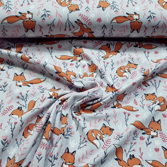 Cotton Jersey Fox Plants Gray fabric - Cotton jerseyfabric with children's drawings of foxes and plants on a gray background. The fabric is 150cm wide and its composition is 95% cotton - 5% elastane.