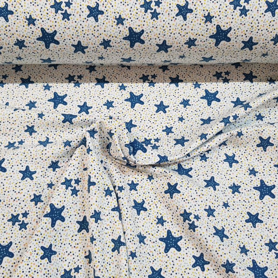 Organic Cotton Jersey Starfish fabric - Organic cotton jersey fabric with blue starfish drawings on a white background with colorful polka dots. The fabric is 150cm wide and its composition is 95% cotton - 5% elastane.