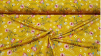 Digital Cotton Jersey Flowers Ocher fabric - Stretch digital cotton jersey fabric with flower drawings on an ocher background. The fabric is 150cm wide and its composition 94% cotton - 6% elastane.