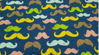 Digital Cotton Jersey Mustaches Colors fabric - Stretch cotton knit fabric in digital drawing of colored mustaches on a blue background. The fabric is 150cm wide and its composition 94% cotton - 6% elastane.