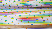 Cotton Jersey Stars Rainbow Stripes fabric - Cotton jersey with drawings digital of stars and stripes in the colors of rainbows on a white background. The fabric is 150cm wide and its composition is 95% cotton - 5% elastane.