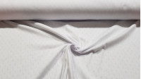 Pointoille Cotton Jersey fabric - Fine knit fabric with small openwork in the shape of diamonds, also called pointoille. It is used a lot in children's clothes, first clothes, underwear, bows... The fabric is 140cm wide and its composition is 100% co