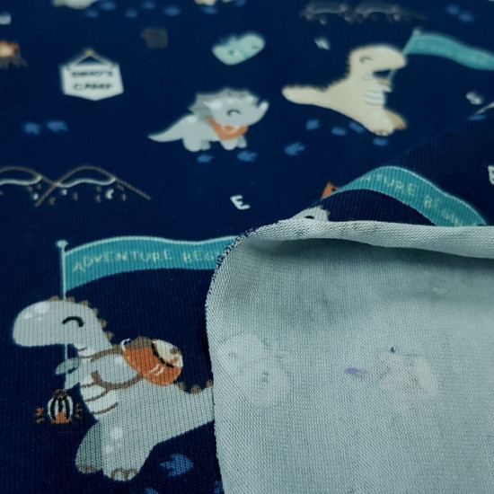 Cotton Jersey Organic Dinosaur Explorers fabric - Organic cotton jersey fabric (GOTS) with drawings of exploring dinosaurs on a dark blue background with exploration and camping motifs. The fabric is 150cm wide and its composition is 95% cotton - 5% elast