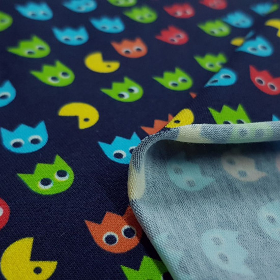 Cotton Jersey Pacman Videogame fabric - Cotton jersey fabric with drawings of the Pacman video gameon a navy blue background. The fabric is 150cm wide and its composition is 94% cotton - 6% elastane.