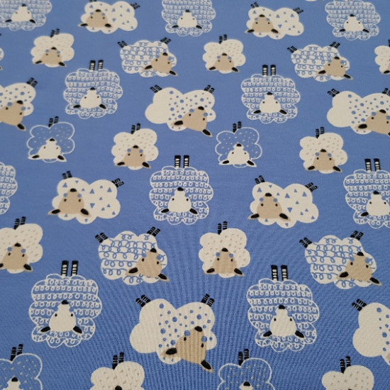 Cotton Jersey Sheep fabric - Children's cotton jersey fabric with drawings of sheep on a plain background. This fabric has two background color options: blue and makeup. The width of the fabric is 150cm and the composition 95% Cotton and 5% Span