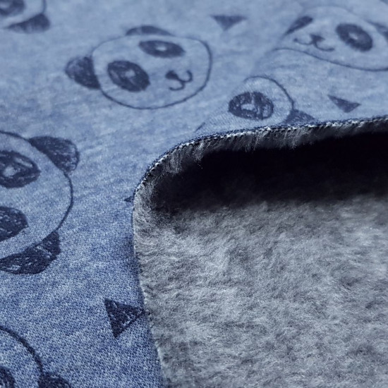 Sweatshirt Alpenfleece Pandas fabric - Alpenfleecesweatshirt fabric with short, soft dark hair on one side, while on the other side there are drawings of panda faces and triangles on a blue background. The fabric is 150cm wide and its composition is