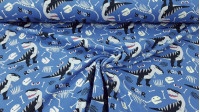 French Terry Sweatshirt Dinosaurs Roar fabric - French Terrysweatshirt fabric, ideal for spring/summer, with drawings of cool dinosaurs, skeletons, bones... on a gray-blue background. The fabric is 150cm wide and its composition 92% cotton - 8% elastane