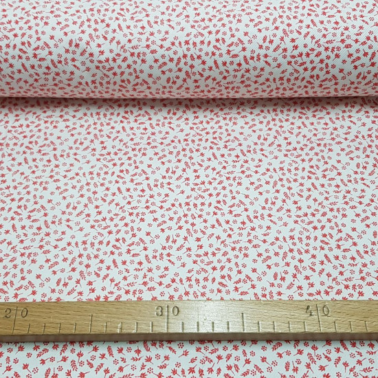 Twill Plush Spikes fabric - Twill fabric with small drawings of spikes and branches in red on a white background. The back of the fabric is like plush, with soft flannel hair. The fabric is 80cm wide and its composition 100% cotton.