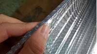 Isothermal Insulated fabric - Isothermal and insulating fabric consisting of a layer of