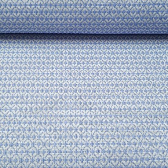 Tela Algodón Brocado Cruces - Tela de algodón brocada con dibujos de cruces en colores azul y blanco. Tela ideal para ceremonias, confecciones infantiles y decoración. La tela mide 140cm de ancho y su composición 100% algodón.