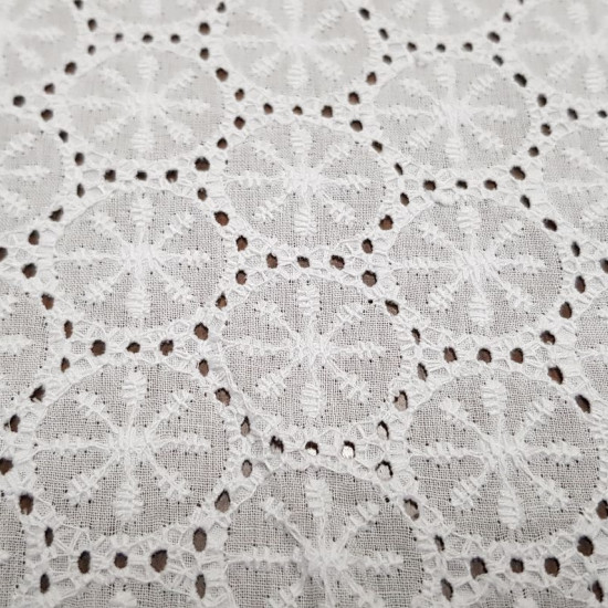 Cotton Embroidery Floral Circles Motifs fabric - Fine white cotton embroidered and perforatedfabric with floral circle motifs. The fabric is between 130-135cm wide and 100% cotton. NOTE: The photo is taken on a dark colored desk to show the drawing.