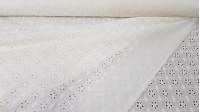 Embroidered Cotton Tiana fabric - Beautiful white embroidered and perforated cotton batiste fabric with large petal flowers. The fabric is 135cm wide and its composition is 100% cotton.