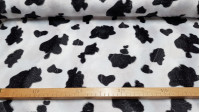 Velboa Cow Print fabric - Velboa short hair fabric with black patterned pattern imitating cow skin. Ideal for animal costumes and also for decorations and other creations. The fabric has a 100% polyester composition and is 150cm wide.