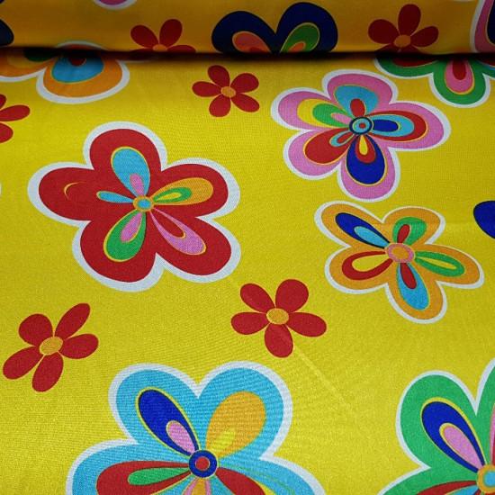 Tela Raso Flores Colores - Tejido de raso brillante, con caída en la que aparecendibujos de flores de colores sobre un fondo amarillo. La tela mide 150cm de ancho y su composición 100% poliester