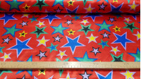 Satin Stars Colors Red Background fabric - Satin fabric with drawings of stars of various sizes and colors on a red background. An ideal fabric for flashy costumes for carnival and other parties. The fabric is 150cm wide and its composition 100% polyester